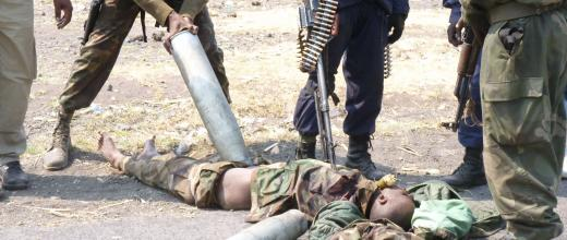 Congolese soldiers desecrate rebel corpses