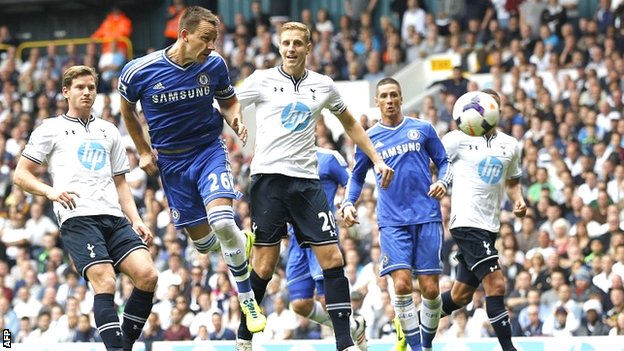 Andre Villas-Boas's reunion with his former mentor Jose Mourinho ended with honours even as John Terry's header gave Chelsea a point at White Hart Lane.