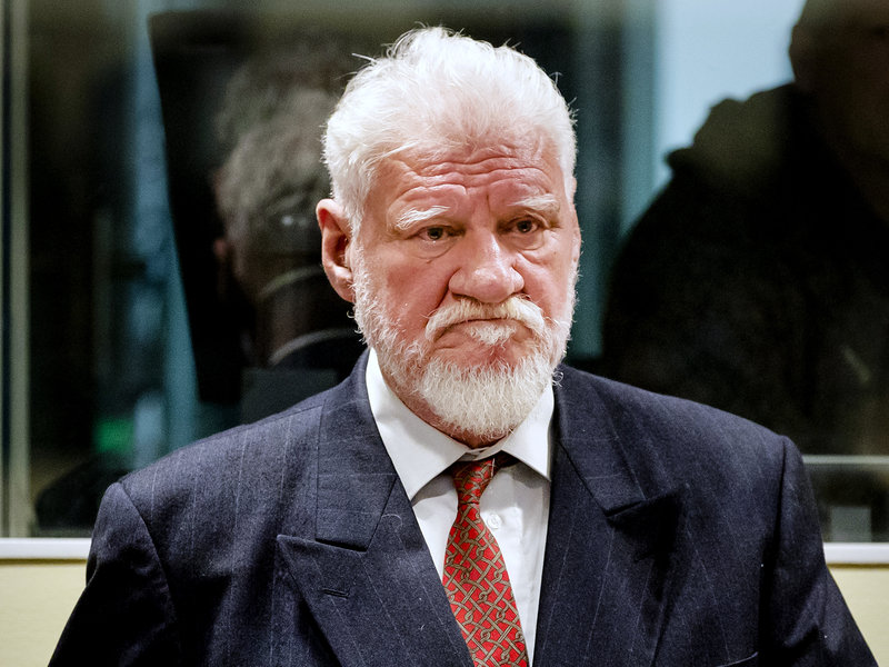 His Sentence Upheld, War Criminal Drinks 'Poison' In Court — And Dies Hours Later